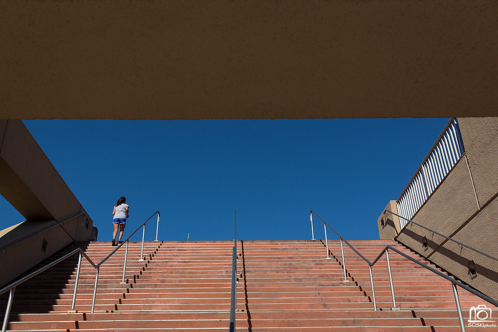 A student runs to the top of the Event Center staircase at San Jose State University in San Jose, California, on August 22, 2014. (Stan Olszewski/SOSKIphoto)
