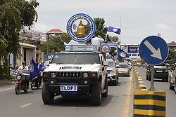 July 27, 2018 - Phnom Penh, Phnom Penh, Cambodia - A long grup of vehicles with LDP (League for Democracy Party) logos and flags  march to Phnom Penh from Ta Khmao where the party rallied in the morning..The Cambodian National Assembly election will be taking place on 29th July 2018. The leader of the majority party will be named the prime minster of the nation. (Credit Image: © Enric Catala/SOPA Images via ZUMA Wire)