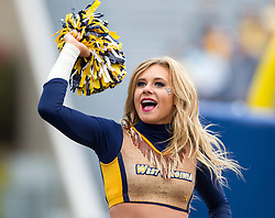 Nov 7, 2015; Morgantown, WV, USA; A West Virginia Mountaineers cheerleader performs during the first quarter at Milan Puskar Stadium. Mandatory Credit: Ben Queen-USA TODAY Sports
