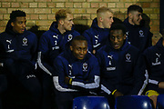 AFC Wimbledon players in the dugout during the EFL Trophy match between Southend United and AFC Wimbledon at Roots Hall, Southend, England on 13 November 2019.