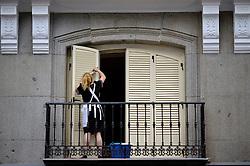 THEMENBILD - Madrid ist seit Jahrhunderten der geographische, politische und kulturelle Mittelpunkt Spaniens (siehe Kastilien) und der Sitz der spanischen Regierung. Hier residieren auch der König, ein katholischer Erzbischof sowie wichtige Verwaltungs- und Militärbehörden. Als Handels- und Finanzzentrum hat die Stadt nationale und internationale Bedeutung. Hier im Bild Zimmermaedchen reinigt Balkontueren in einem Hotel // THEMATIC PACKAGES - Madrid is the capital and largest city of Spain. The population of the city is roughly 3.3 million and the entire population of the Madrid metropolitan area is calculated to be around 6.5 million. It is the third-largest city in the European Union, after London and Berlin, and its metropolitan area is the third-largest in the European Union after London and Paris. The city spans a total of 604.3 km2. EXPA Pictures © 2014, PhotoCredit: EXPA/ Eibner-Pressefoto/ Weber<br /> <br /> *****ATTENTION - OUT of GER*****