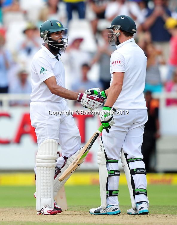 Hashim Amla shakes hands with AB de Villiers after going to his 50 during day 2 of the Sunfoil Test Series 2014/15 game between South Africa and the West Indies at Newlands Stadium, Cape Town on 3 January 2015 ©Ryan Wilkisky/BackpagePix