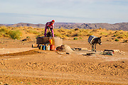 Arab woman; getting water, at well, near Erfoud; Morocco; People; Sahara Desert
