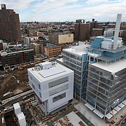 March 8, 2017 - New York, NY : Columbia University's Manhattanville campus is rising on a 17-acre site in West Harlem, north of Columbia's Morningside Heights campus.  The Renzo Piano-designed Lenfest Center for the Arts, center left, and Jerome L. Greene Science Center, center right, are slated to open this Spring. CREDIT: Karsten Moran for The New York Times