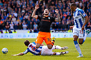 Huddersfield Town midfielder Jonathan Hogg (6) fouls Sheffield Wednesday midfielder Daniel Pudil (36)  during the EFL Sky Bet Championship play off first leg match between Huddersfield Town and Sheffield Wednesday at the John Smiths Stadium, Huddersfield, England on 14 May 2017. Photo by Simon Davies.