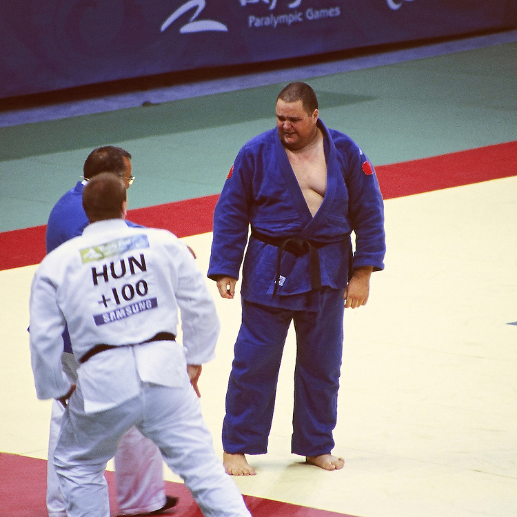 PARALYMPICS Day 3 - Beijing 2008<br /> Judo - Julien TAURINES vs Gabor PAPP<br /> French judoka Julien TAURINES during his match against Gabor PAPP (Hun) in the men +100 kg category for the bronze medal contest in the paralympic Games. TAURINES wins by an ippon (1000 points). Beijing, Worker's Gymnasium, September 09 2008.<br /> High resolution available.