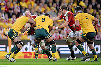 22 June 2013; Paul O'Connell, British & Irish Lions, is tackled by Ben Mowen, left, and Wycliff Palu, Australia. British & Irish Lions Tour 2013, 1st Test, Australia v British & Irish Lions, Suncorp Stadium, Brisbane, Queensland, Australia. Picture credit: Stephen McCarthy / SPORTSFILE