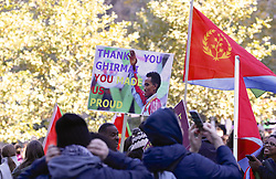 November 6, 2016 - New York, New York, U.S - With autumn leaves as a backdrop, fans of today's New York City Marathon winner Ghirmay Ghebreslassie, the first Eritrean and the youngest man ever to win the race, honored him by raising signs and flags of his country even before he crossed the finish line, cheering him on along the race route. (Credit Image: © Staton Rabin via ZUMA Wire)