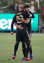 April 29, 2018 - Los Angeles, California, U.S - Benny Feilhaber #33 of the LAFC hugs Laurent Ciman #23 after he scores the winning goal during their MLS game against the Seattle Sounders on Sunday April 29, 2018, their first game at the Banc of California Stadium in Los Angeles, California. LAFC defeats Sounders, 1-0. (Credit Image: © Prensa Internacional via ZUMA Wire)