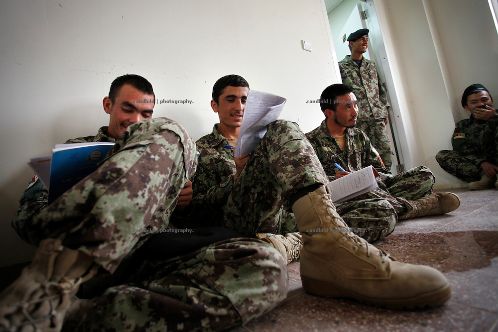 Trainers give religion and writing lessons for Afghan National Army recruts in Camp Pamir near Kunduz, Northern Afghanistan