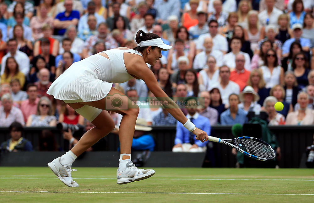 Garbine Muguruza in action against Venus Williams in the Ladie's Singles final on day twelve of the Wimbledon Championships at The All England Lawn Tennis and Croquet Club, Wimbledon.