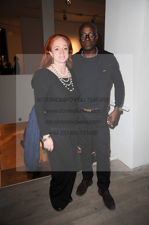 CAMILLA LOWTHER and CHARLES ABOAH at a private view of Masters of Photography - A Journey presented by Macallan and Albert Watson held at Philips De Pury, Howick Place, London SW1 on 1st December 2010.
