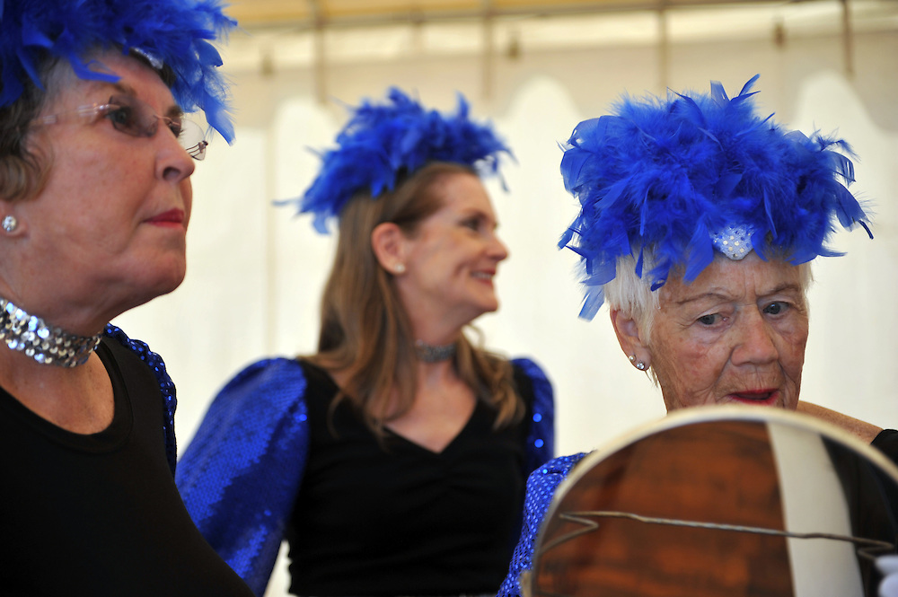 Xavier Mascareñas/Treasure Coast Newspapers; Clarice Willis, right, of Hobe Sound, prepares with her fellow Treasure Coast Tappers to perform at the Martin County Fair on Seniors Day on Tuesday. The dance troupe performed seven routines as the opening act on day five of the fair.