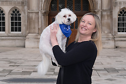 © Licensed to London News Pictures. 20/02/2017. LONDON, UK.  Gabby (Gabrielle) with Vinnie the dog outside Mayor's and City of London court in London for a hearing against their property management company, Victory Place. Gabby and Florian Kuehnn from Limehouse in east London claim they were told their pet dog, a Yorkshire terrier cross, Vinnie could live in their flat when they purchased it, but the management firm, Victory Place has subsequently insisted it has has a blanket no-pets policy. The animal rescue charity, All Dogs Matter are backing the couple and says no-pet rules see thousands of pets dumped each year and the rules are particularly unfair on the elderly and vulnerable who rely on pets for support and companionship.  Photo credit: Vickie Flores/LNP