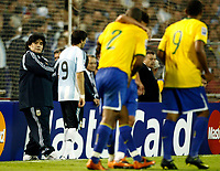 ARGENTINA Vs BRAZIL in the South American Soccer derby for the FIFA World Cup S.Africa 2010 Qualification round.<br /> Argentine head coach DIEGO MARADONA observing Brazilian players celebrating their last goal.<br /> Rosario , Argentina Septiembre 05, 2009<br /> © PikoPress