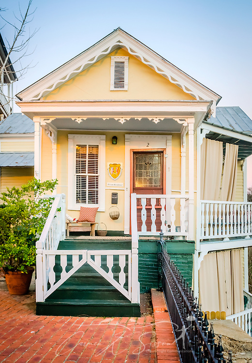 """The sun sets on the Bridgetender's Cottage, Feb. 14, 2015, in Selma, Alabama. The house was built circa 1883 or 1884 and overlooks the Alabama River. The """"bridgetender"""" lived in the house and oversaw the operations of the nearby span bridge, opening and closing the span for ships to pass through and collecting tolls. Dallas County purchased the bridge and stopped collecting tolls in 1899. The bridge was replaced by the nearby Edmund Pettus Bridge in 1940. The cottage is now a private residence and is listed on the National Register of Historic Places. (Photo by Carmen K. Sisson/Cloudybright)"""