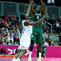 06 August 2012: Nigeria Chamberlain Oguchi takes a jumpshot over France Yannick Bokolo during 79-73 Team France victory over Team Nigeria, during the men's basketball preliminary, at the Basketball Arena, in London, Great Britain.