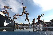 Jul 26, 2019; Des Moines, IA, USA; General overall view as Emma Coburn  (6) races over the water jump in the women's steeplechase during the USATF Championships at Drake Stadium.