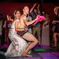 """The amazing groom Rob """"Speedo-Rob"""" showing off his best moves to Sofia on the dance floor of Club Regina, Puerto Vallarta. Fearless Award Photo by: Melissa Suneson."""
