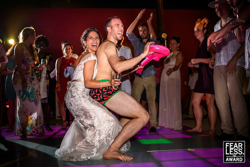 "The amazing groom Rob ""Speedo-Rob"" showing off his best moves to Sofia on the dance floor of Club Regina, Puerto Vallarta. Fearless Award Photo by: Melissa Suneson."