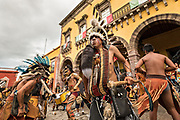 Mexican Concheros dance in a ceremony in the Jardin Allende during the week long fiesta of the patron saint Saint Michael October 1, 2017 in San Miguel de Allende, Mexico.
