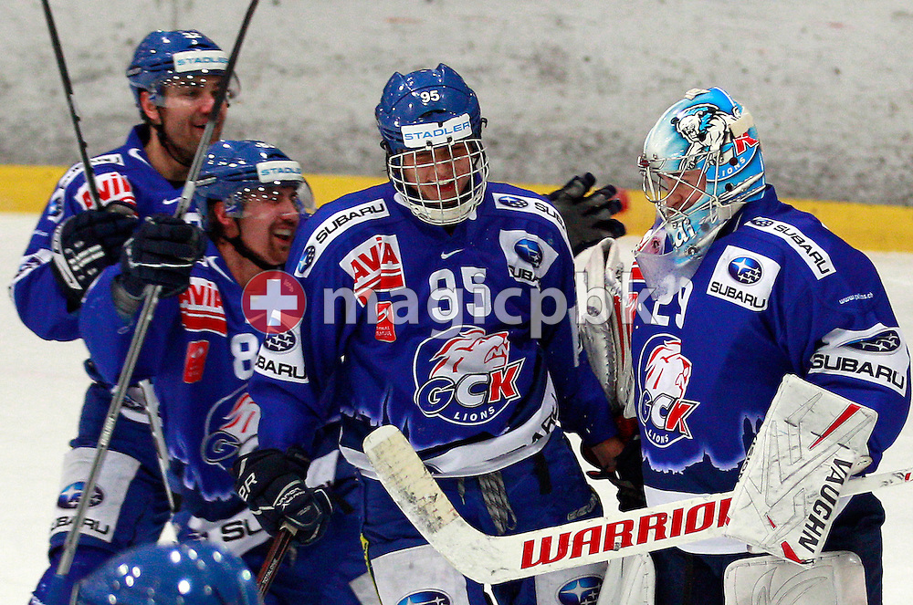 GCK Lions defenseman Phil Baltisberger (CR), goaltender Lukas Meili (R) and their teammates Steven Widmer (CL) and Marc Zangger (L) celebrate their victory after the ice hockey game of the Swiss National League B (Season 2011-2012) between GCK Lions and Lausanne HC held at the KEK in Kuesnacht, Switzerland, Tuesday, Nov. 22, 2011. (Photo by Patrick B. Kraemer / MAGICPBK)