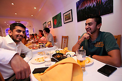 UK ENGLAND LONDON 15SEP16 - IT consultant Mahesh Gujadur (28, R) and his colleague Chirag Suchak (28, L) enjoy a meal at The Bengal Village curry restaurant on Brick Lane in London's east end.<br /> <br /> jre/Photo by Jiri Rezac<br /> <br /> © Jiri Rezac 2016
