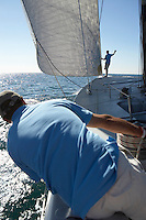 Sailors on yacht in ocean