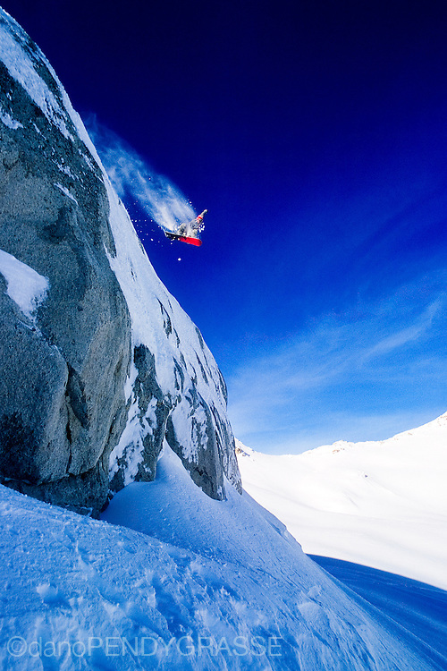 Dionne Delesalle drops a big cliff in the Whistler backcountry