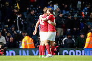 Nottingham Forest midfielder Henri Lansbury (10) celebrating with Nottingham Forest midfielder Robert Tesche (32) during the Sky Bet Championship match between Fulham and Nottingham Forest at Craven Cottage, London, England on 23 April 2016. Photo by Matthew Redman.