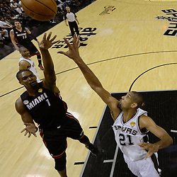 Jun 13, 2013; San Antonio, TX, USA; Miami Heat center Chris Bosh (1) shoots against San Antonio Spurs power forward Tim Duncan (21) during the first half of game four of the 2013 NBA Finals at the AT&T Center. Mandatory Credit: Derick E. Hingle-USA TODAY Sports