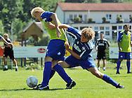 07-08-2008 Voetbal:Willem II:Bad-Schandau:Duitsland<br /> Willem II is in Oost Duitsland in Bad-Schandau voor een trainingskamp.<br /> Frank Demouge van achteren verdedigt door Arjan Swinkels tijdens de training vanochtend<br /> <br /> foto: Geert van Erven
