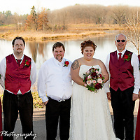 The bride and groom with their attendants during a beautiful fall wedding.