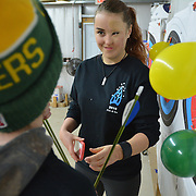 "NORTH YARMOUTH, Maine,  -- 1/17/16 --  Tatyana Shakhray, 18, guides a fellow ""Fire and Ice"" camper camper during target practice at Lakeside Archery in North Yarmouth on Sunday. <br /> 23 child victims of burns came together in southern Maine over the weekend as part of the 10th Fire & Ice Burn Survivors Winter Camp put on by the Portland Firefighters Children's Burn Foundation. Portland area firefighters served as camp counselors - bringing the teens to the Camden Snow Bowl, Lakeside Archery and several other regional locations for group events and personal support activities.  <br /> As an 18-year-old camper, this is Shakhray's last year to participate. She hopes to be selected as a counselor next year.  <br /> Fire and Ice started in 2005 with four burn victims and nine counselors. This year there were 23 youth campers from all over New England participating in a three-day event. Campers came together by doing series of activities in which they bond and become close friends. ""These kids have all been through similar traumatic expereinces,"" said Portland Firefighter and counselor Sheldon Gregiore.  <br /> A first-time youth camper (whose identity is being kept anonymous) said, ""All I can say is, burned people rule!""  <br /> For more information, register or donate visit: http://www.maineburnsurvivors.org. <br /> Photo © Roger S. Duncan 2016 for The Forecaster."