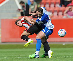 Tom Parkes of Bristol Rovers jostles for the ball with Billy Waters of Cheltenham Town - Mandatory by-line: Dougie Allward/JMP - 25/07/2015 - SPORT - FOOTBALL - Cheltenham Town,England - Whaddon Road - Cheltenham Town v Bristol Rovers - Pre-Season Friendly