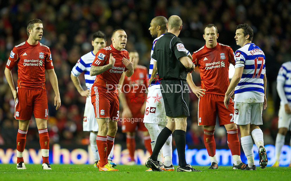 LIVERPOOL, ENGLAND - Saturday, December 10, 2011: Liverpool's Craig Bellamy argues with the referee against Queens Park Rangers during the Premiership match at Anfield. (Pic by David Rawcliffe/Propaganda)