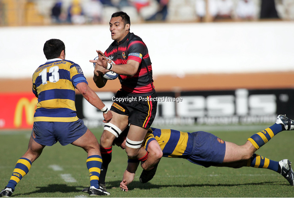 George Naoupu looks to fend off Rua Tipoki from BOP during the NPC First Division, Ranfurly Shield clash between the Bay Of Plenty Steamers and Canterbury at Blue Chip Stadium, Tauranga, Sunday September 05, 2004. Canterbury won the match, 33 - 26, to secure the shield.<br />PHOTO: Hannah Johnston/PHTOSPORT