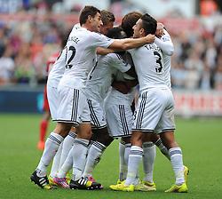 Swansea City's Wayne Routledge celebrates with team. - Photo mandatory by-line: Alex James/JMP - Mobile: 07966 386802 30/08/2014 - SPORT - FOOTBALL - Swansea - Liberty Stadium - Swansea City v West Brom - Barclays Premier League