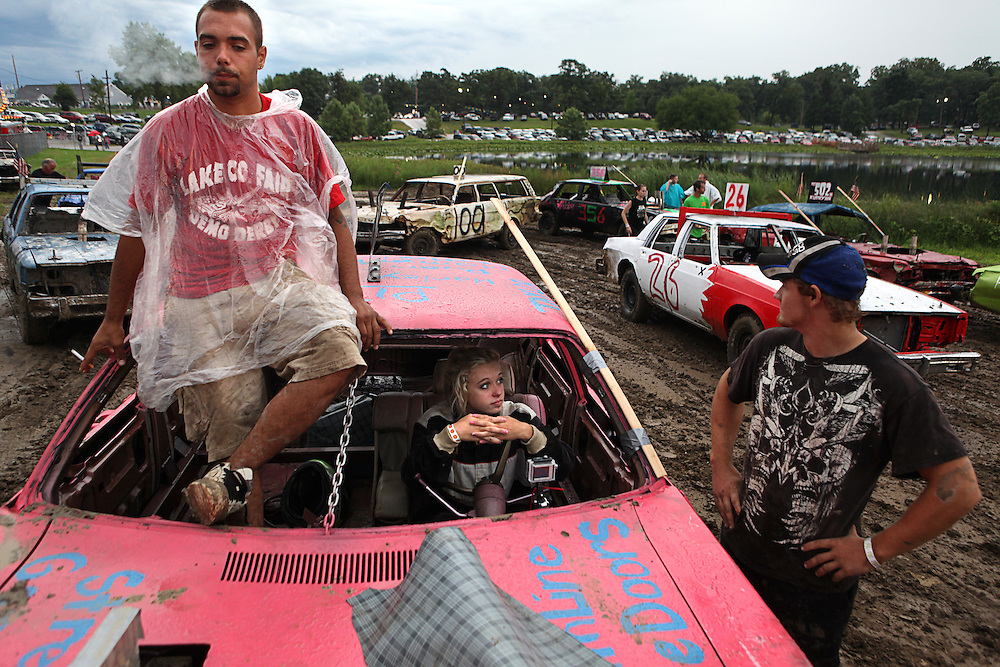 Taylor waits for her heat to start with family friend and coach Dillon Meadows, left, at the Lake County Fair demolition derby in Crown Point on Saturday August, 13, 2011.