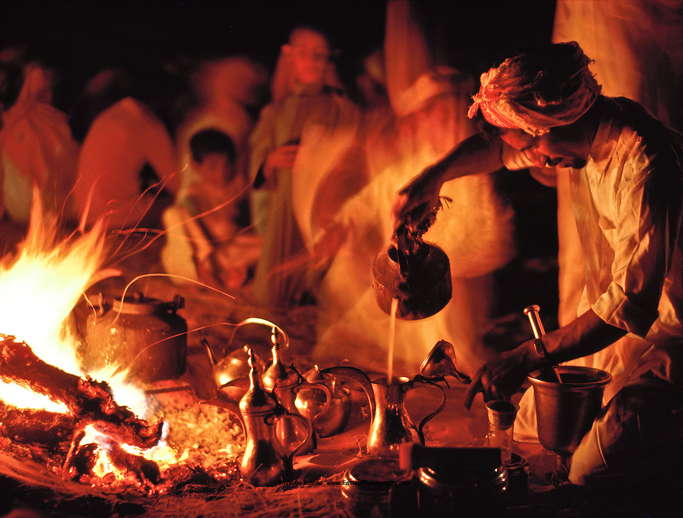 Bedouin preparing Arabic coffee in the desert, Dahana Sands, Saudi Arabia