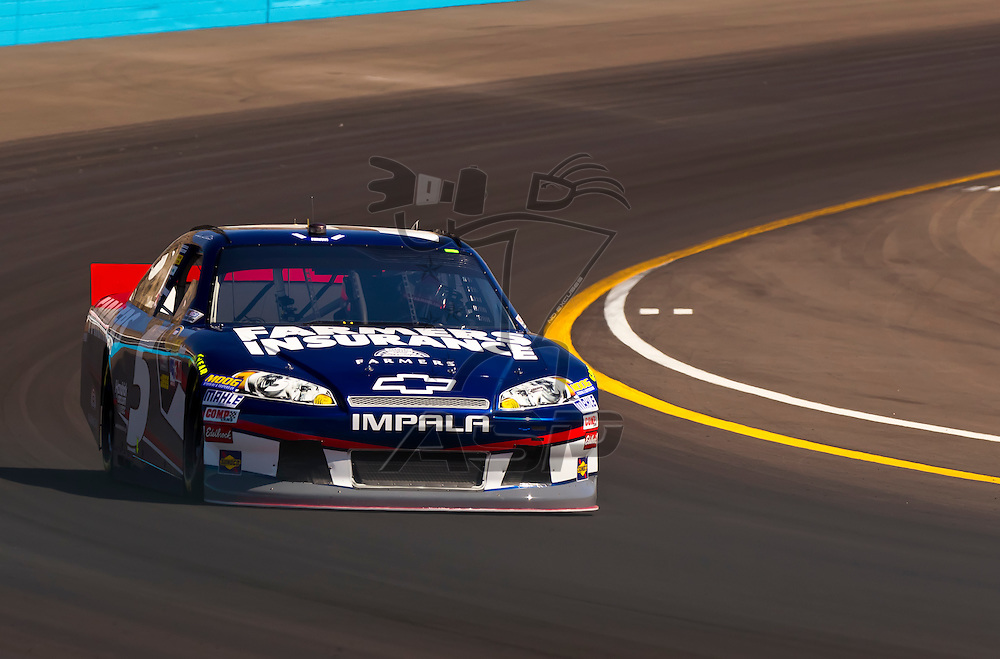 AVONDALE, AZ - MAR 03, 2012:  Kasey Kahne (5) brings his NASCAR Sprint Cup car through turn 4 during qualifying for the Subway Fresh Fit 500 race at the Phoenix International Raceway in Avondale, AZ.