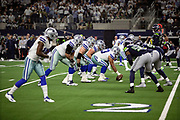 The Dallas Cowboys offensive line gets set to snap the ball at the line of scrimmage opposite the Seattle Seahawks defensive line during the NFL football NFC wild card playoff game against the Seattle Seahawks on Saturday, Jan. 5, 2019 in Arlington, Tex. The Cowboys won the game 24-22. (©Paul Anthony Spinelli)
