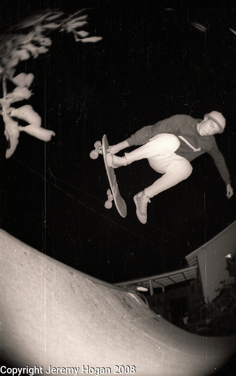 Skateboarder Tom Knox, who was recently sponsored by Santa Cruz Skateboards catches air from a small ramp in Visalia, California in late 1987. Knox went on to be the one of the top rated street skaters in the world.