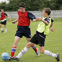 Alan Horan of Moher Celtic (in yellow) dives for the tackle as he takes part in the U-15 and U-16 Irish team soccer trials in Newtown on Friday.<br /><br />Photograph by Yvonne Vaughan.
