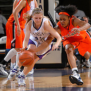 Kansas State guard Kari Kincaid (L) and Illinois guard Lacey Simpson (R) battle for a loose ball during first half action at Bramlage Coliseum in Manhattan, Kansas, March 22, 2007.  Kansas State defeated Illinois in the third round of the WNIT 66-51.