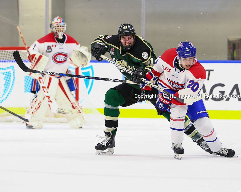 BUFFALO, NY - SEP 26,  2016: Ontario Junior Hockey League game between Toronto and Cobourg, Justin Vernace #20 of the Toronto Jr. Canadiens battles for control during the second period<br /> (Photo by Hark Nijjar/ OJHL Images)