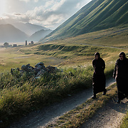 'Morchili' Mariami (left) and 'Deda' Natalia strolling from the small abbey where they live in the village of Abano in the Truso Valley, to the village of Ketrisi, to purchase a cup of cream from a nomad family. The valley leads to the frontier of the occupied territory of South Ossetia in the Mtskheta-Mtianeti region of Georgia, and is all but abandoned. For most of the year the valley is home only to a lone homesteader, a monk, and four nuns and a priest who live in the abbey.