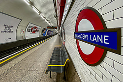 March 19, 2020, London, England, United Kingdom: General view of an empty subway platform at Chancery Lane Underground Station. Transport for London announced the closure of up to 40 stations as officials advised against non-essential travel. Bus and London Overground service will also be reduced. (Credit Image: © Alberto Pezzali/NurPhoto via ZUMA Press)