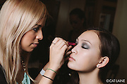 PROVIDENCE, RI - FEB 13: Jacey Vizzacco creates the dramatic smoky eye look on Jacqueline Kieu for the Alistair Archer show during StyleWeek NorthEast on February 13, 2015 in Providence, Rhode Island. (Photo by Cat Laine)
