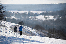 © Licensed to London News Pictures. 30/01/2019. Butlers Cross, UK.  Walkers make their way through a snow covered landscape on Coombe Hill in Butlers Cross, Buckinghamshire, as snow hits the south east of England. Photo credit: Ben Cawthra/LNP